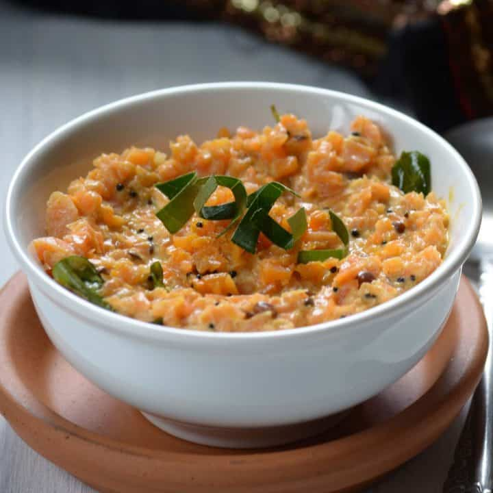 carrot pachadi/salad is Kerala style food. This recipe requires grated carrots combined with yogurt Seasoned with mustard