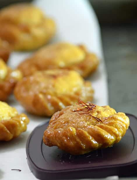 This Badusha Recipe yields crispy outer and soft inside delicious sweet which just melts in your mouth. Perfect for Diwali, holi or any happy occasions and party.