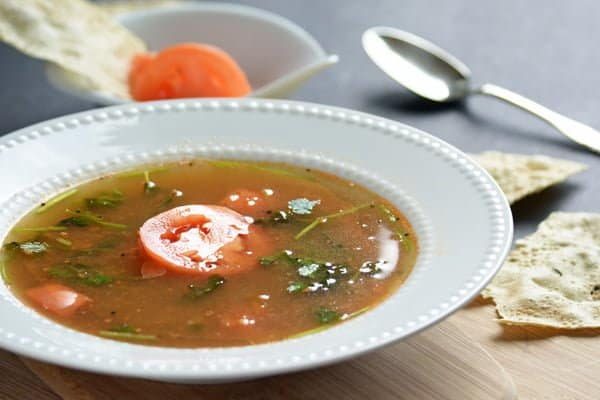 dry roasting and grinding the spices in this tomato rasam recipe, you can straight away add readymade rasam powder mixture.