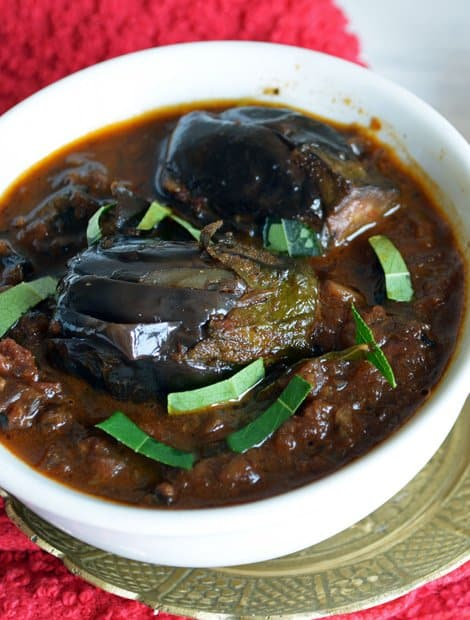 Baby eggplant curry served in a bowl to pair Indian spiced rice dishes like biryani or pulao as a side dish.