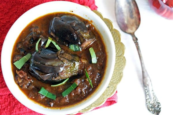 Baby eggplant curry, an authentic Indian side dish that is hot, spicy, slightly tangy.  The gravy is most desirable to serve with Indian staple food Biryani.