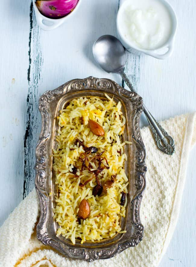 Kashmiri Pulao Recipe, always turnouts as a super hit dish whenever we make at home. It is very flavorful, rich but mild and with the hint of sweetness of dry fruits. The good part is that it is easier to make. The procedure is easy to remember great and additionally works perfect for the beginners.  Here you will see, the Step by step pictures, tips and variations and also serving suggestions.