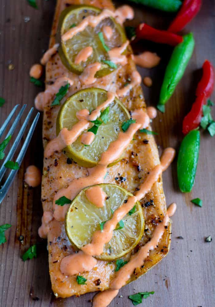 Grilled Cedar Plank Salmon recipe, yields soft, juicy smoke flavored salmon with the right hint of herbs. The salmon great in taste and texture something similar to the restaurant's quality.