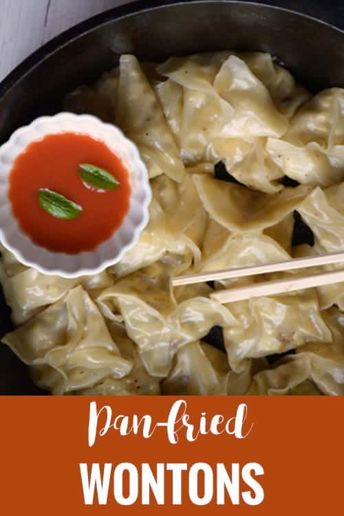 Pan fried wontons recipe- vegetarian Chinese dumplings are made with wonton wrapper, vegetables like cabbage, carrot. A tasty appetizer which is soft, chewy and crispy at the bottom. Very easy and simple to make, perfect for parties and families.