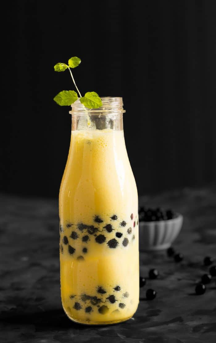 Mango boba smoothie recipe is made with fresh mango, yogurt, and boba. A sweet tropical smoothie can be served for the breakfast or mid-day meals.