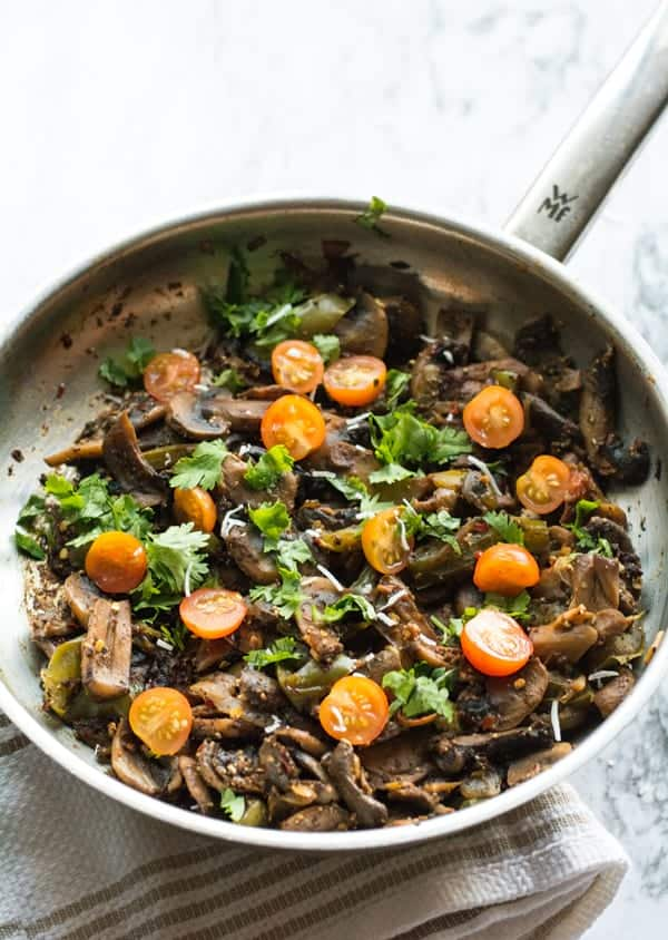 Mushroom pepper fry recipe made with fresh button mushrooms, green peppers, crushed black pepper. A vegan, spicy, Indian style side dish perfect for easy weeknight dinners.