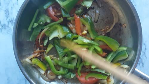 adding vegetables for mushroom pepper fry recipe