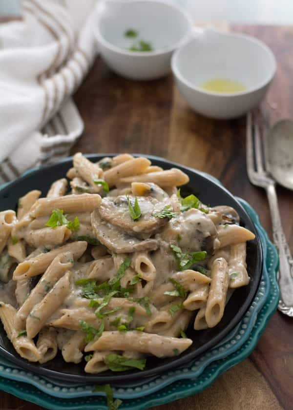 One pot skinny cream of mushroom pasta sauce seasoned with crushed peppercorn and cilantro, made made in less than 20 minutes.