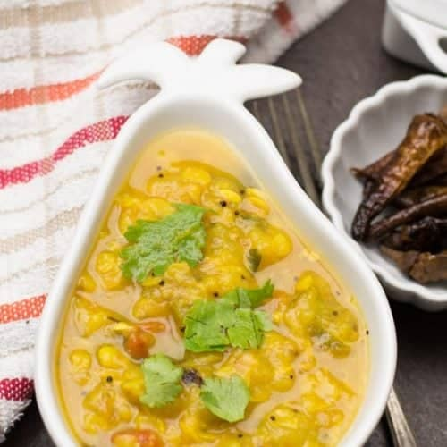 Dosakaya pappu-Andhra style dal made with yellow cucumbers, toor dal, onion, tomatoes, and turmeric powder. This healthy dosakaya pappu is one of the most popular and classic recipes South India.