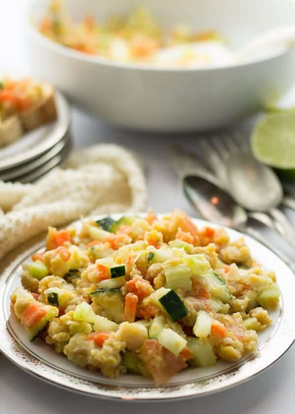 Mashed chickpea salad, a Mediterranean style vegan recipe. Made with cucumber, carrot, tomato, onion. Serve this salad as warm or cold. A healthy, low calorie vegetarian dish perfect for sandwiches and wrap.