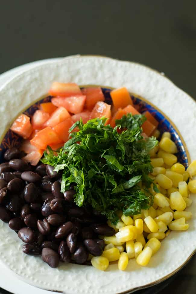 the key ingredients for this black bean corn avocado salad are the black bean, corn kernels, avocado, cilantro.