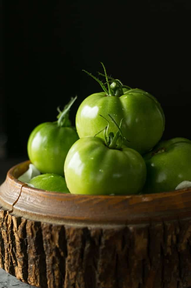 Getting garden fresh green tomatoes to make salsa verde from the back yard.