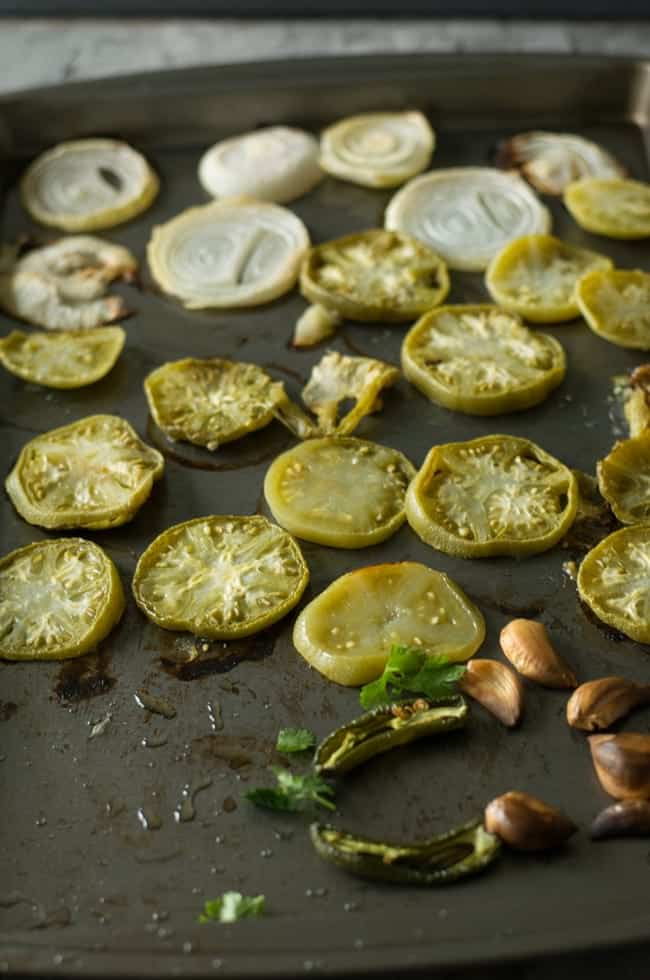 Roast vegetables by keeping in preheated oven on 400°F for 20minutes to make perfect oven roasted green tomato salsa.