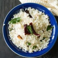 Indian Coconut Rice Recipe is simple and straightforward which takes less than 5 minutes to make effortlessly. A best satisfying food for busy days or weeknight dinners which is gluten free, dairy free, vegan and vegetarian recipe.