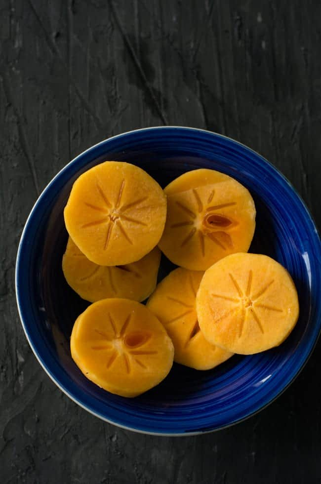 how to cut persimmon to make persimmon smoothie. Peel and slice them.