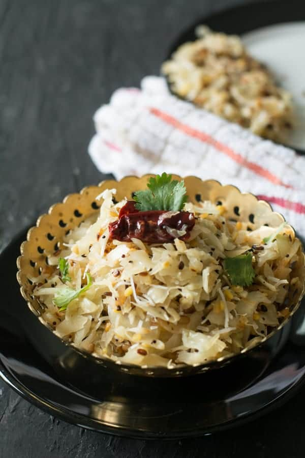 Cabbage poriyal-Indian style cabbage stir-fry made with shredded cabbage, coconut, and mustard seeds. Another simple everyday side dish recipe in less than 15 minutes.
