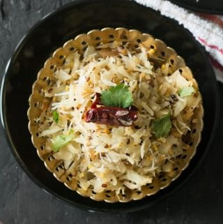 Cabbage poriyal-Indian style cabbage stir-fry made with shredded cabbage, shredded coconut and seasoned with mustard seeds. Another simple everyday side dish recipe made in less than 15 minutes from scratch.
