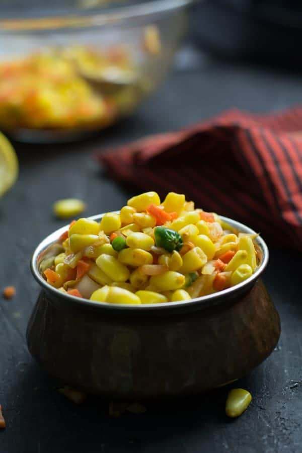 serving corn chaat or corn masala in a bowl.