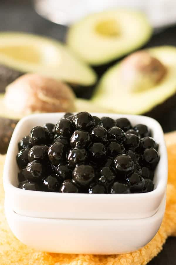 To make avocado boba tea, Boba is available in different sizes and two colors. Black and white. When cooked, the large varieties would turn to the size of small marbles. The large black size is the one you get in takeouts and in restaurants.