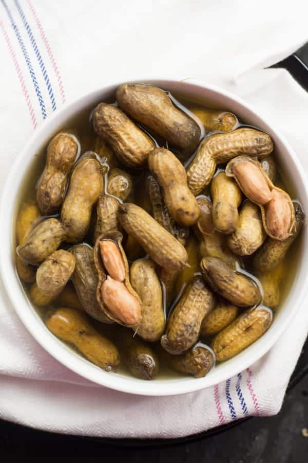 peanuts with the sells on in a bowl with the salty cooked water. Instant pot boiled peanuts makes the regular snacking time to the family time, where everyone sits together and munching on peanuts and share their stories.