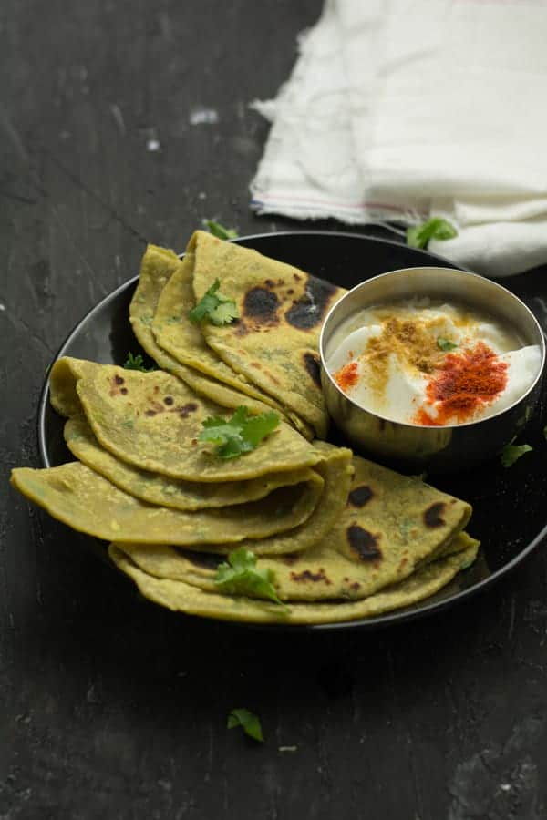 Avocado Paratha has neutral flavor, taste and looks green in color. While tasting no one can predict the ingredient of the paratha unless you disclose them. Accordingly, this became one of the tasty paratha recipes for lunch box and one of the easy avocado recipes for kids.