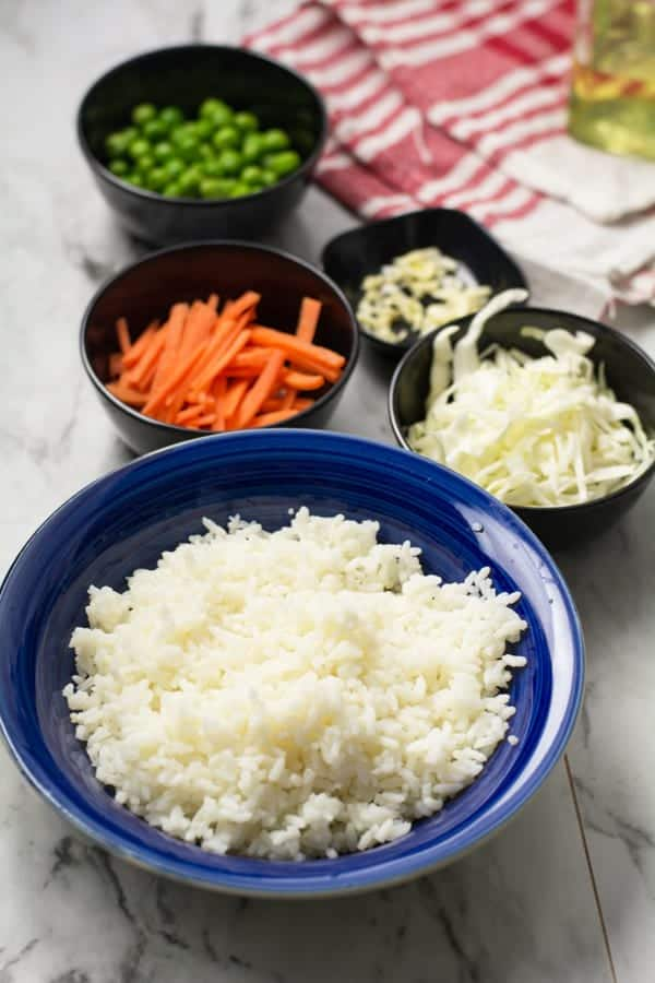 ingredients for egg rice with cut vegetables.