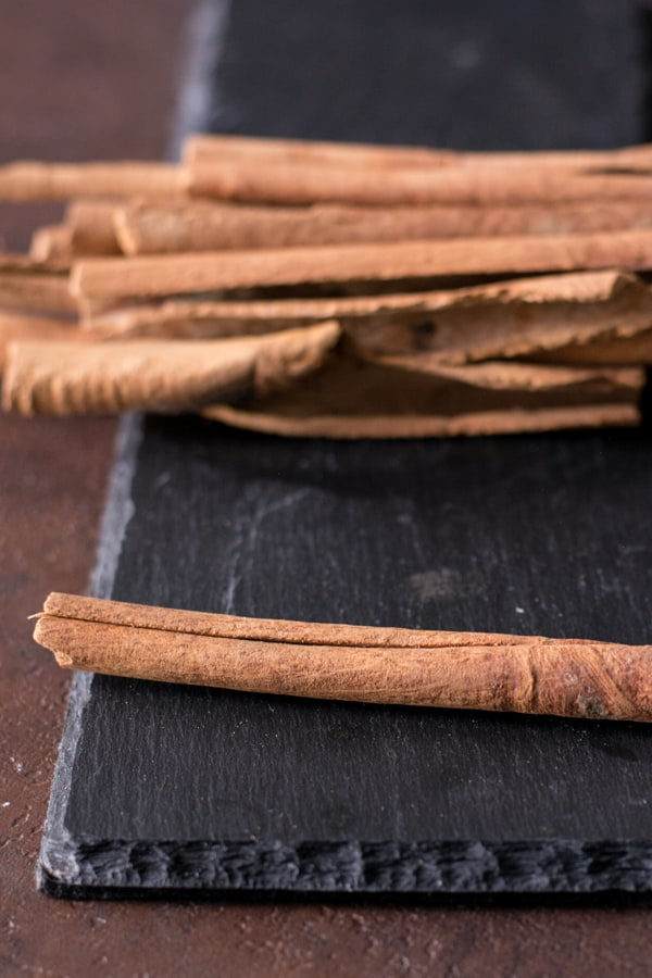 In India cinnamon is used mainly in the non-vegetarian / meat recipes. It is generally used to combat the raw flavors of the meat.