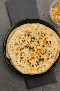 Onion kulcha recipe is one of the best homemade Indian bread recipes for dinner that you'll ever eat! Soft, fluffy, delicious, stuffed with onion and other spices. This onion kulcha is wholesome, and you will never realize that this kulcha bread is made actually with whole wheat flour and in tawa.