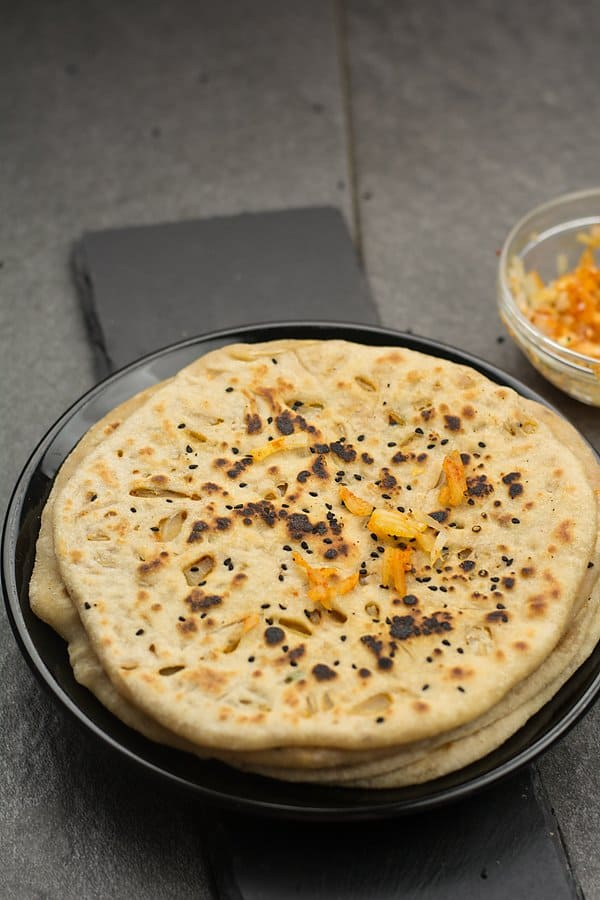 Why you should make this onion kulcha recipe? This is easy and simple made in tawa or oven. Made with healthy ingredients, and will not leave you with the guilt of eating fatty or unhealthy food.