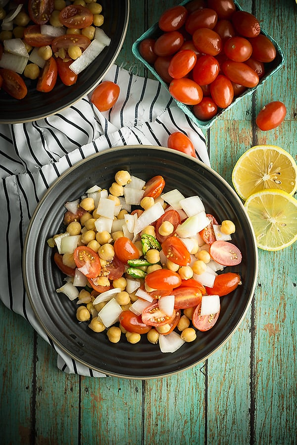 Indian tomato salad is vegan, vegetarian salad. A delicious and quick Indian meal accompaniments. And the best salad to go with butter chicken. Just roughly chop the vegetables and toss with the spices.