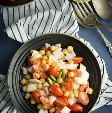 Indian tomato salad, is loaded with tomatoes, onion, healthy vegan protein chickpea. Means, a healthy, easy, wholesome dinner for your busy weeknight.