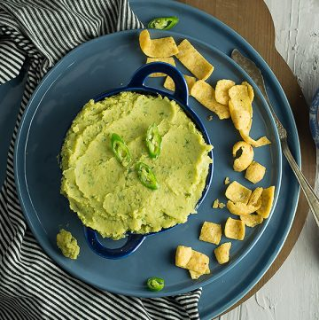 This green chili hummus is the delectable blend of healthy hummus from the middle eastern cuisine with the spicy Maxican's green chili.Ready in less than 10 minutes without using traditional tahini sauce