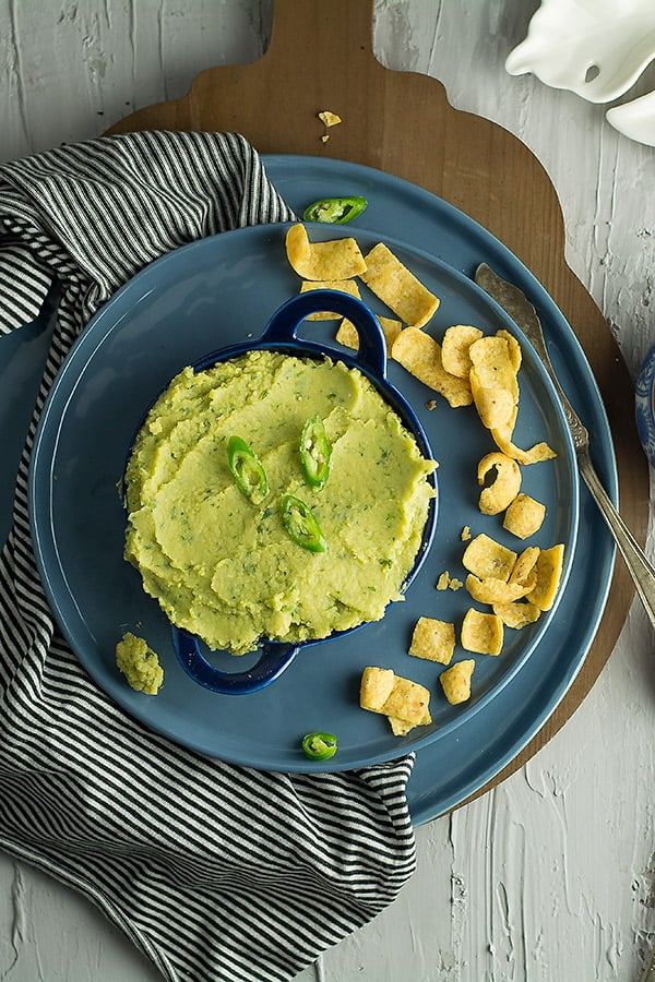 This green chili hummus is the delectable blend of healthy hummus from the middle eastern cuisine with the spicy  Mexican's green chili.Ready in less than 10 minutes without using traditional tahini sauce