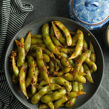 This spicy garlic edamame is ready like a flash perfect for your spicy cravings. Made with frozen edamame, garlic, and chili sauce.