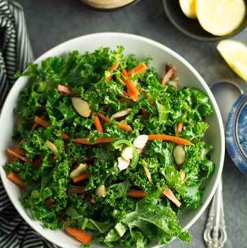 Spicy kale salad with lime vinaigrette dressing-healthy, delicious crunchy salad with finger-licking homemade lime vinaigrette. This spicy kale is the best of all recipes.