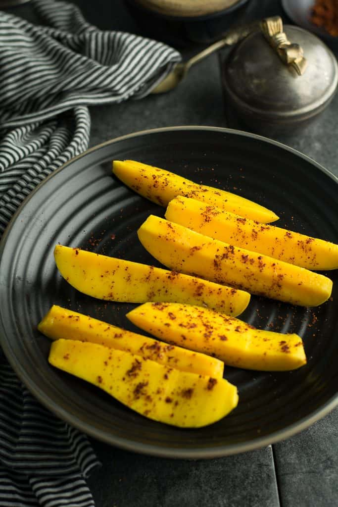 Mango with chili powder is a spicy fruit snack  that ready under 5 minutes.