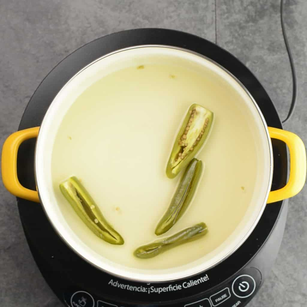 Cook the jalapeno peppers for 10 minutes until it becomes soft and tender and the syrup becomes to a running consistency.