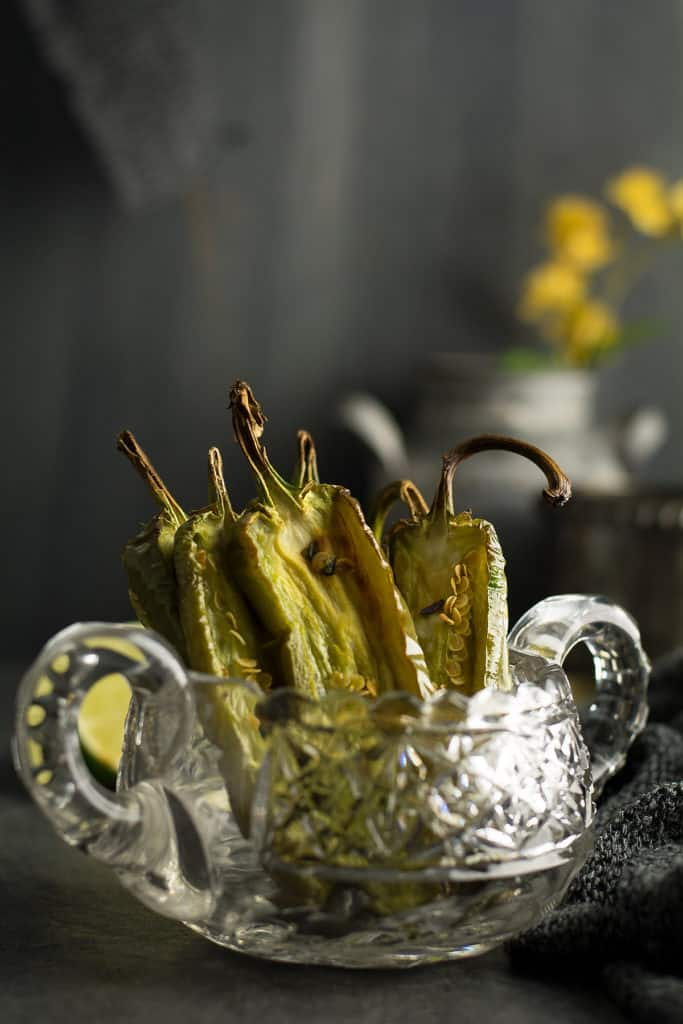 How to roast jalapeno with the oven or grill. Roasted jalapeno in a decorative glass bowl.