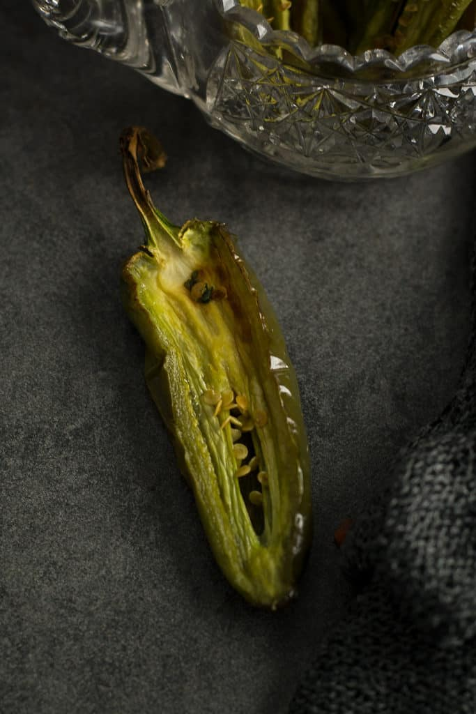 Perfectly roasted jalapeno shown as a slice.