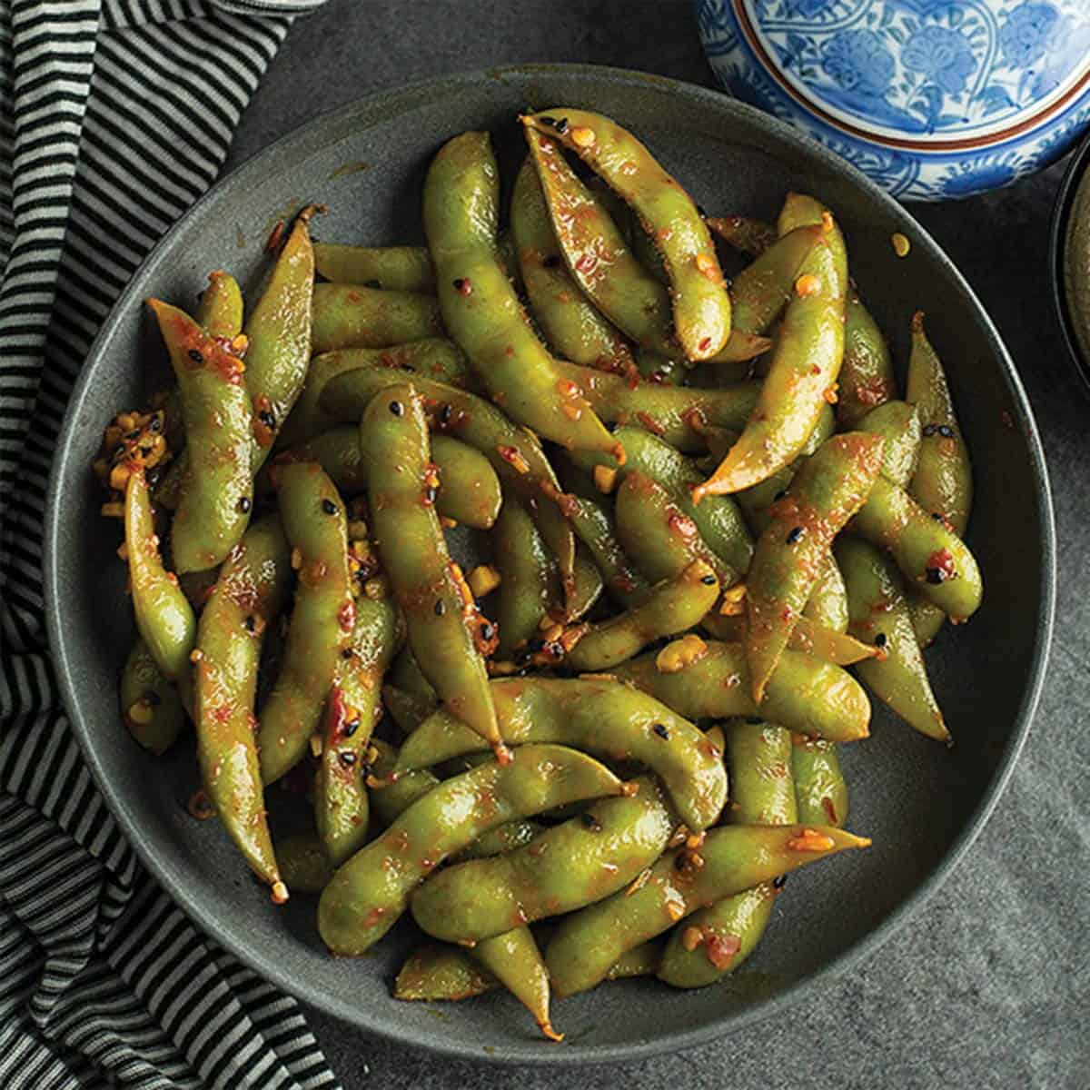 spicy garlic edamame is ready like a flash perfect for your spicy cravings. Made with frozen edamame, garlic, and chili sauce.