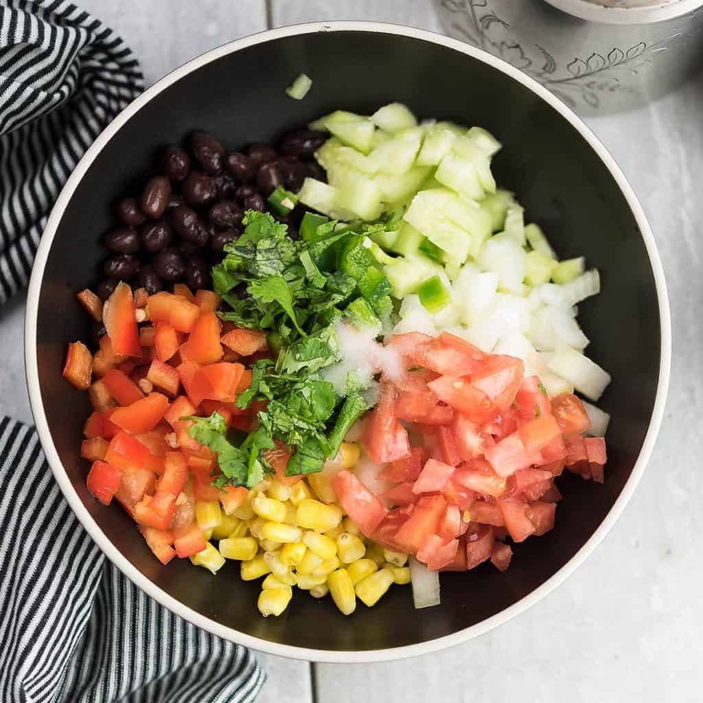 All the ingredients are chopped and prepped for making the salad for taco.