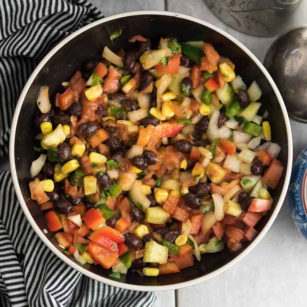 The salsa is mixed to make the delicious corn side dish.