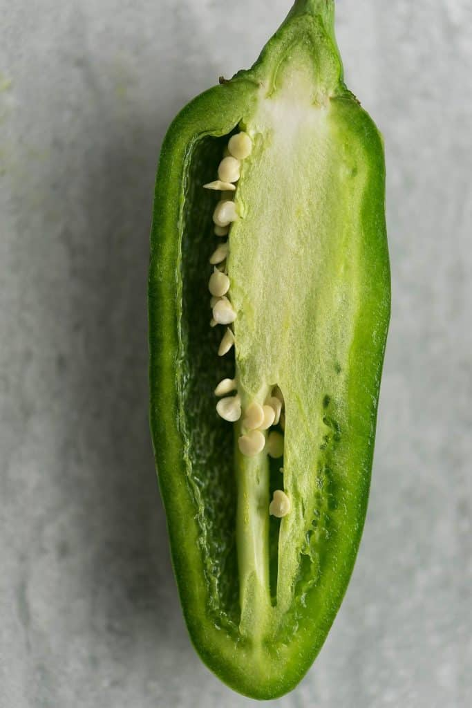 The seeds and the white membrane holds most of the heat. A jalapeno with the seeds and the membrane is the picture.