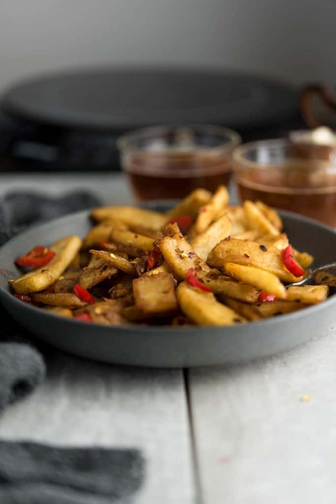 This spicy sauce coated  Chinese fries is  served with tea