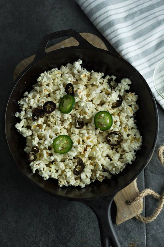 This spiced jalapeno popcorn is flavorful, mildly spicy placed over a pan.