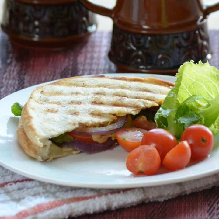 The grilled veggie sandwich is a healthy and quick recipe, made with onion, tomato, cucumber, avocado. P