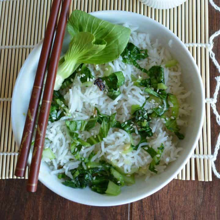 Bok choy fried rice, a Chinese style lunch menu served with chopsticks.