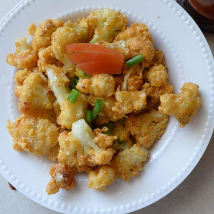 cauliflower golden fry served as appetizer.