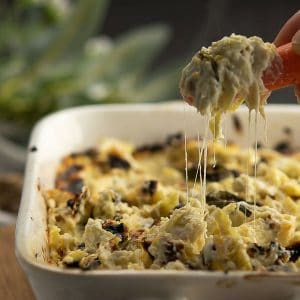 Jalapeno artichoke dip is creamy, cheesy, spicy, an excellent side to snack with pretzels, veggies, crackers, and more.