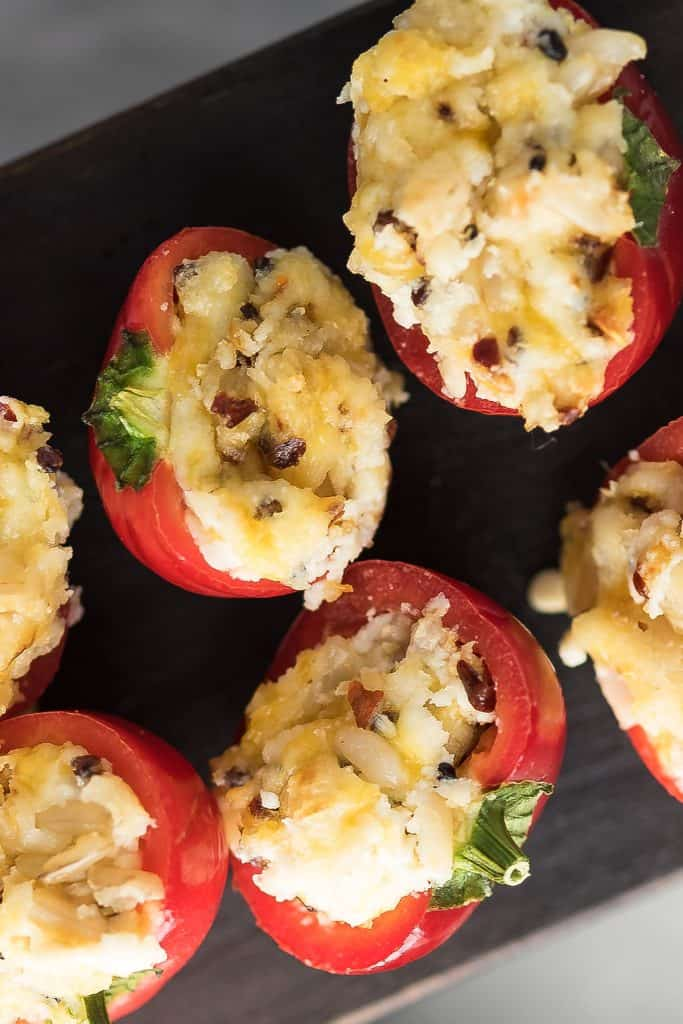 stuffed cherry peppers are arranged in a plate for serving.